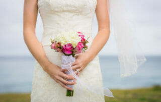 bride at the beach in a destination wedding