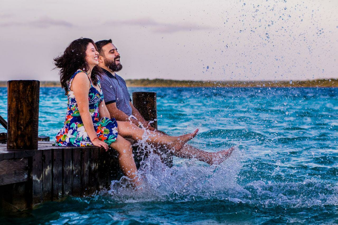 couple splashing water with their feet