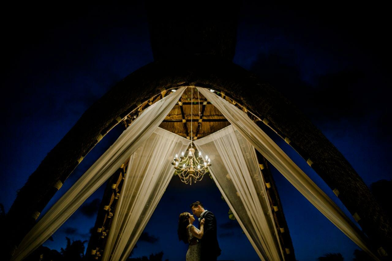 couple below beautiful gazebo